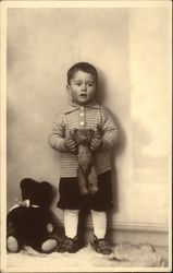 Little Boy in Knickers holding Teddy Bear
