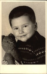 Portrait Photograph of Young Boy with Teddy Bear