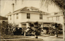 Photo of Home with Car in Front