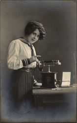 Woman in Nautical Themed Attire standing next to Telephone