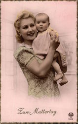 Blonde Woman Holding Baby