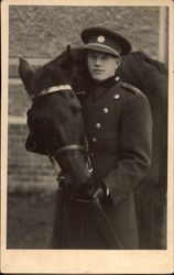 Young Man in Uniform with Black Horse