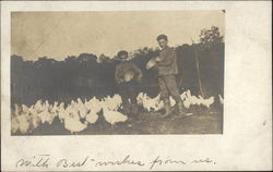 Vintage Photograph of Two Boys feeding Chickens