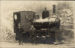 Two Men with Small Locomotive on Train Track