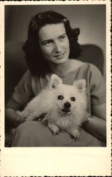 Brunette Woman holding White Dog
