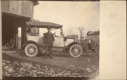 Man Standing in Front of Model T Ford