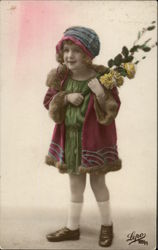 Young Girl in Coat & Hat holding Yellow Flowers