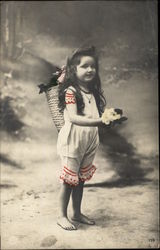 Photograph of Young Barefoot Brunette Girl holding Flowers