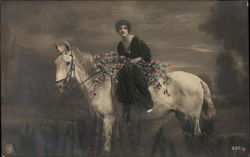 Brunette Woman holding Floral Branches on White Horse