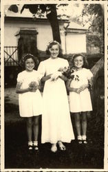 Three Young Girls Dressed in White