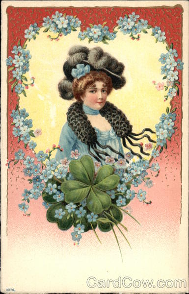 Woman wearing Large Plumed Hat framed with Blue Flowers & Shamrocks