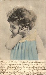 Little Girl in Blue Listening to a Pocket Watch