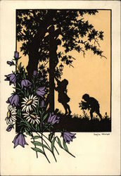 Silhouette of Children PIcking Flowers and Climbing a Tree