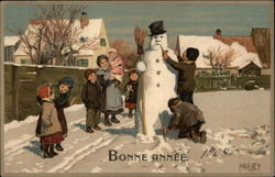 Group of Children Making a Snowman