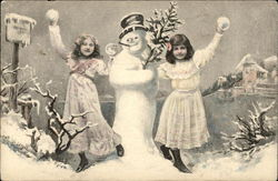 Two Girls Playing in the Snow beside a Snowman