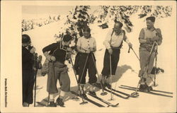 Group on the Slope wearing Snow Skis