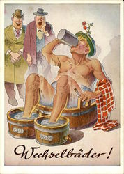 Man drinking while bathing his body & feet in barrels