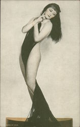 Nude Woman with Long Dark Hair Holding Long Black Scarf Draped Between Her Legs