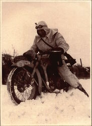 Photo: Nazi Soldier on Motorcycle in Snow