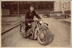 Photo: Nazi Soldier on Motorcycle