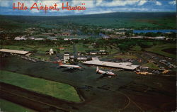 Aerial View of Airport with City and Mauna Kea in the Background