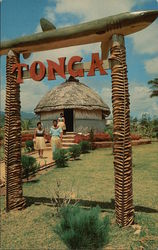 Two Tonga Villagers Walk Down the Path From the Replica Queen's Hut in the Polynesian Center