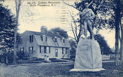 Soldiers Monument with House in the Background