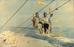Happy Skiers Riding Mile Long Double Chair Lift at Greek Peak