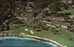 Aerial View of Pebble Beach Lodge, shops, and Famous 18th Hole on the Golf Course