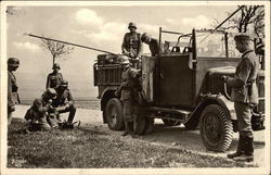 German Nazi Soldiers on Road in Transport Vehicle