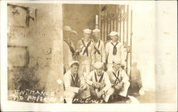 USS Texas Sailors Posing at Prison Gate Entrance