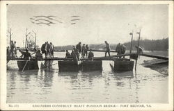 Engineers construct heavy pontoon bridge