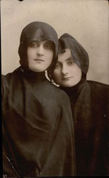 Two Women in Black Hooded Robes