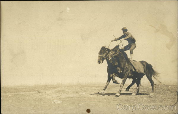 Man Stunt Riding Two Horses Cowboy Western