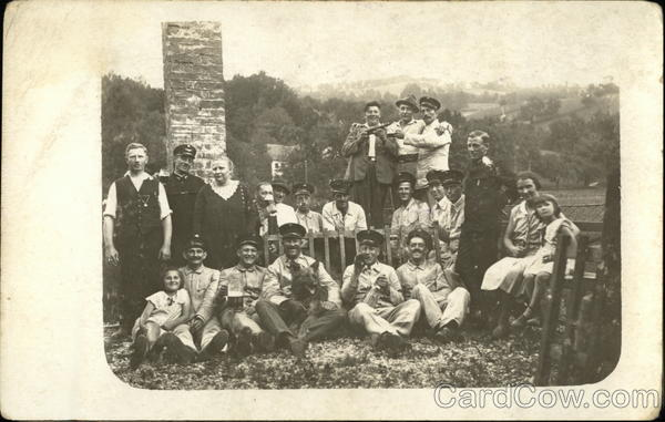 Portrait of Family In Front of Old Chimney