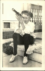 School Boy on the Porch Steps with a Spyglass