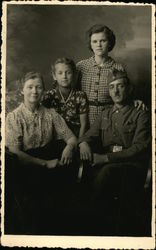 German Soldier with Wife and Daughters
