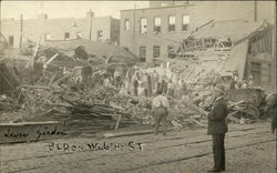 Cleaning up the Tornado Wreckage - Building on W. 6th Street