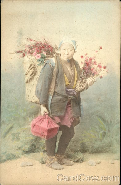 Asian Woman Carrying Flowers and Bundle