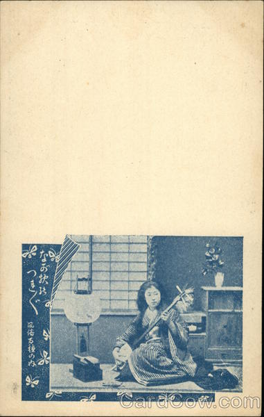 Photo of Woman Playing a Shamisen