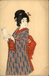 Woman Wearing Kimono Holds A Letter