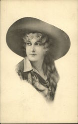 Woman with Long Curly Hair Wearing Cowboy Hat