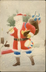 Santa with blue pants carrying tree and toys