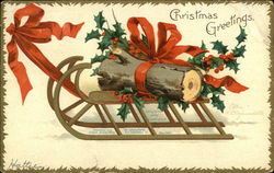 Yule Log on Sled, Tied with Holly and Red Bow