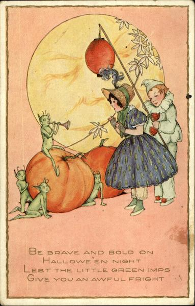 Pumpkins, Green Imps, And Two Children In Costume Halloween