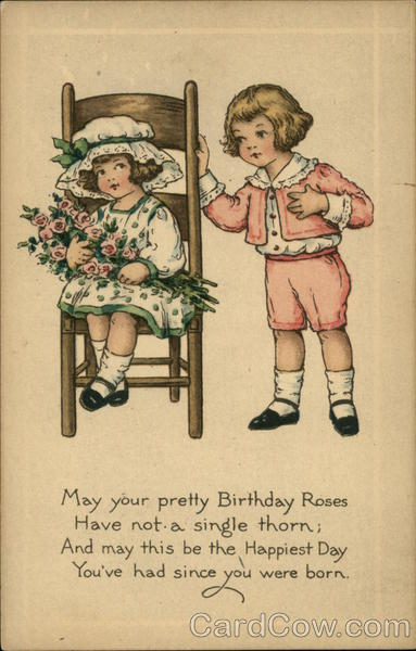 Boy in Pink Giving Girl in Chair Pink Roses Birthday