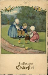 Three Children With Bunny, Chicks, and Basket of Colored Eggs