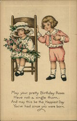 Boy in Pink Giving Girl in Chair Pink Roses