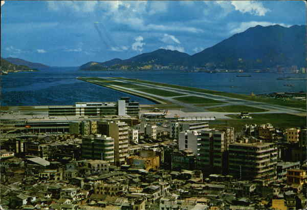 Kai Tak Airport with its modern runway that pointing the Lyemoon Pass Hong Kong