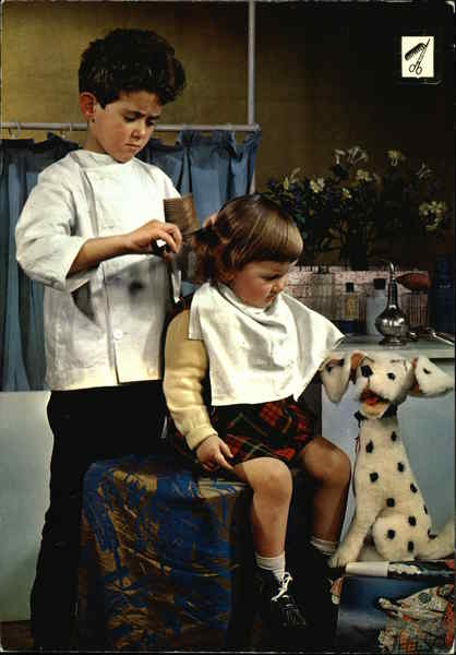 A picture of a boy pretending to be a haidresser and a girl pretending to be his customer
